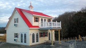 24x24 Two- Story Vinyl Jefferson w/ Dormer & Deck